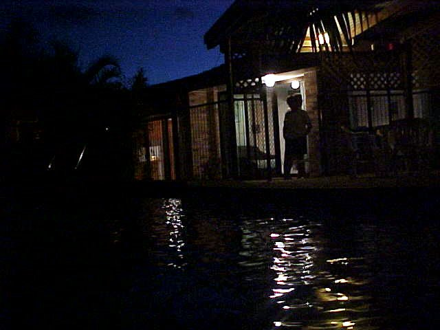 Night shot, as seen from a corner of their swimming pool.
