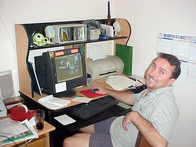 Merv: I just got sacked this week!      Behind his computer he writes many job applications and does a course in PaintShopPro.