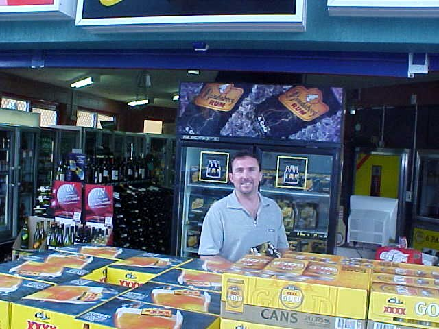 Merv at the local bottle shop, doing shoppings for tonights barbeque!