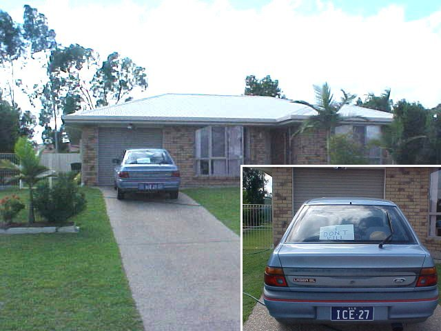 The home of Merv and Trish Smith in Rockhampton. Nice number plate! Nice sign of me behind the window...