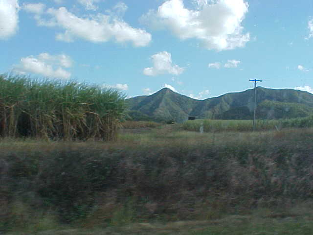 Honestly, there isnt much between Mackay and Airlie Beach... Some sugar cane, some mountains...