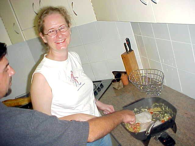 Finally I caught Julie Brice cooking dinner for us all. Friend Andy tastes the quality.