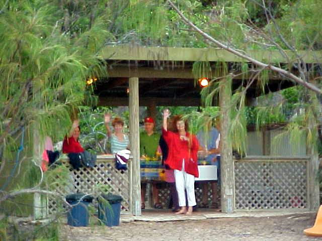 Friends and family had come over to join in their regular Sunday dinner at the beach. I also want a hut like that on my beach!