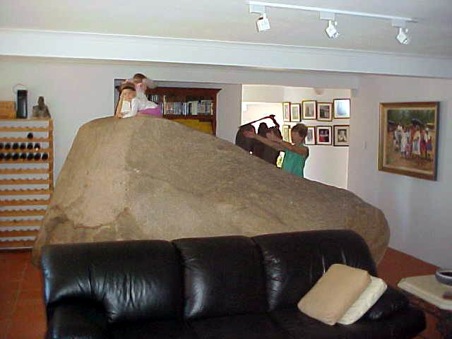 It is just a small rock, but it was to heavy to move when the house was built. The television room was just built around it. Dolby around the rock, you can say!