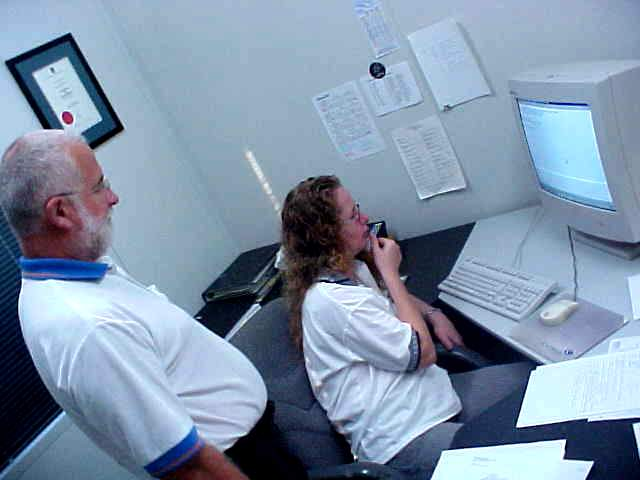 At their office, Julie and Norm do the last preparations for their meeting in Cairns.