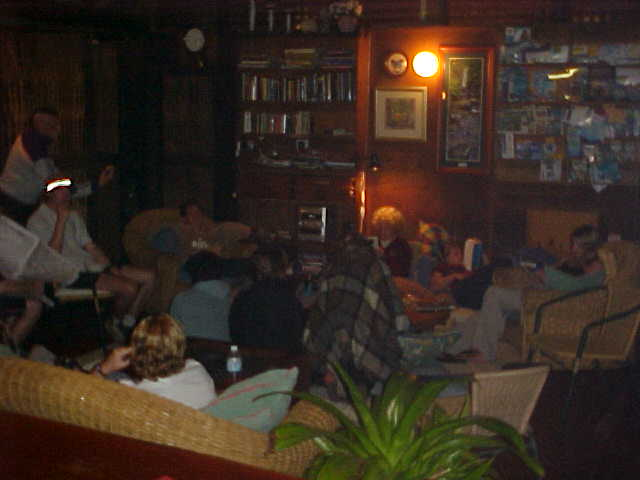 Guests relaxing in the home-like living area.