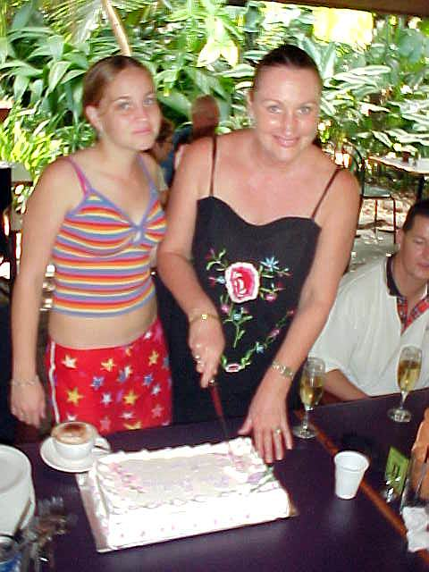 Brianne joined her mum who cuts the birthday cake.