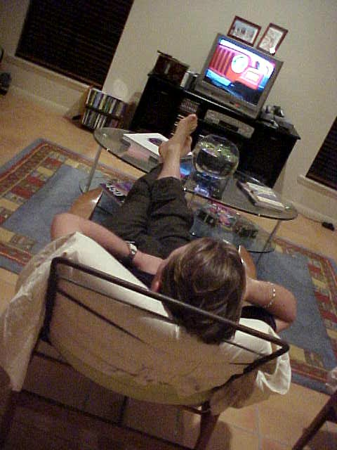 Luke just came home from his job at the real estate, selling houses. Feet up, TV on!