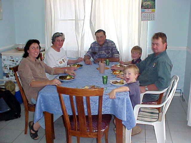 The family on a lunch bite in the kitchen.