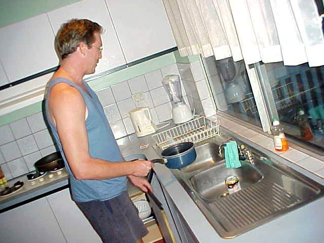 His friends in the house were looking akward. Normally Ed never touches a pan to prepare dinner...