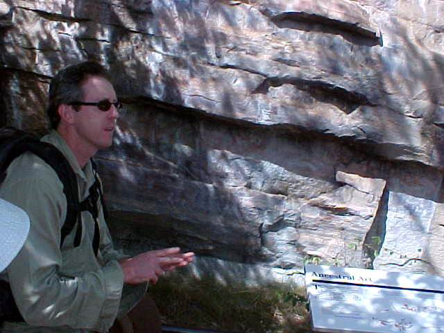 Ed explains the different meanings of the primitive paintings on the rocks.