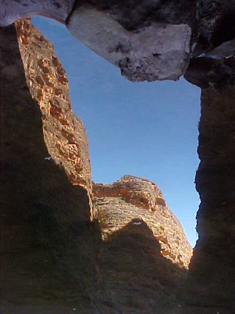 For this photograph you have to turn your monitor up-side-down as I have rotated it 180 degrees. It is actually a reflection in the water at the Cathedral Gorge...