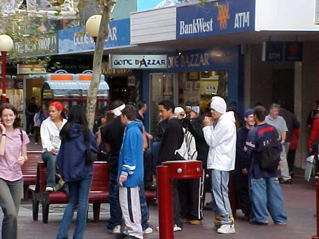 Gathered tough-acting youth in one the shopping streets.