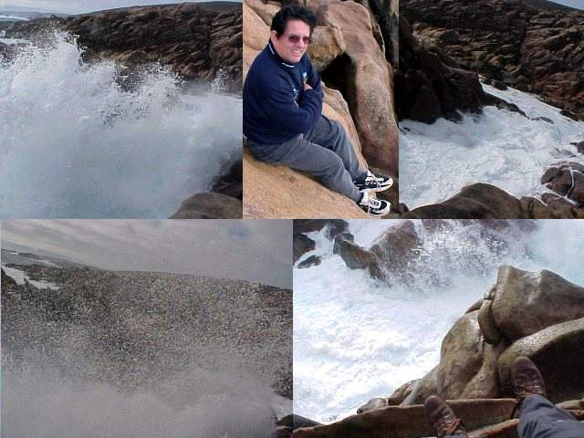 John enjoyed his spot on the rocks, with the white foamy waters splashing up just below him.