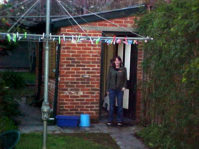 Alexandra shows me the bathroom. Yep, toilets and shower are in this outside house. Fun!