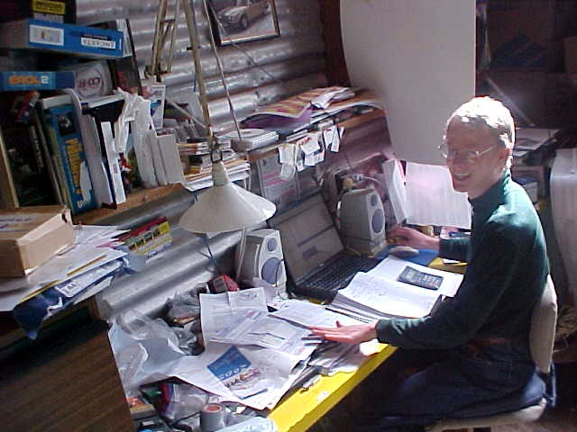 Michael Offe in his room in the shed. Laptop and paperwork, because Michael runs his own business from here.