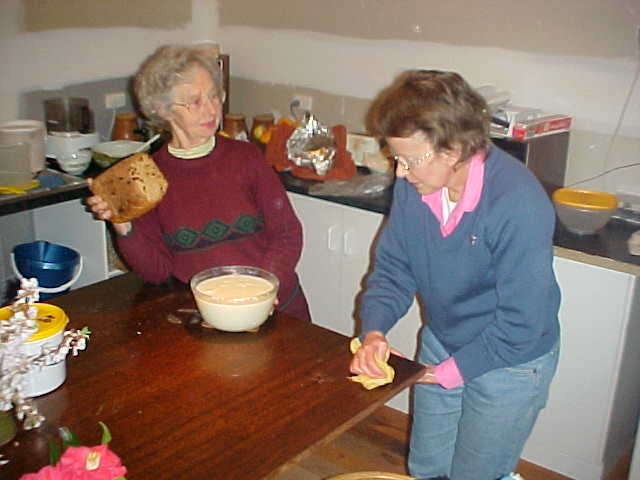 Grandma shows off her self-made bread and custard.