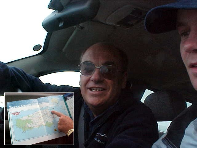 Marc Warren, my tour guide for the day, shows me a map of the island.