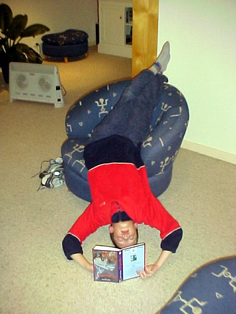 It is true. This is how Jop is reading a book. He started sitting up straight and slowly turned in all kinds of different positions until he found the solution. Up-side-down. Crazy Dutch folks...