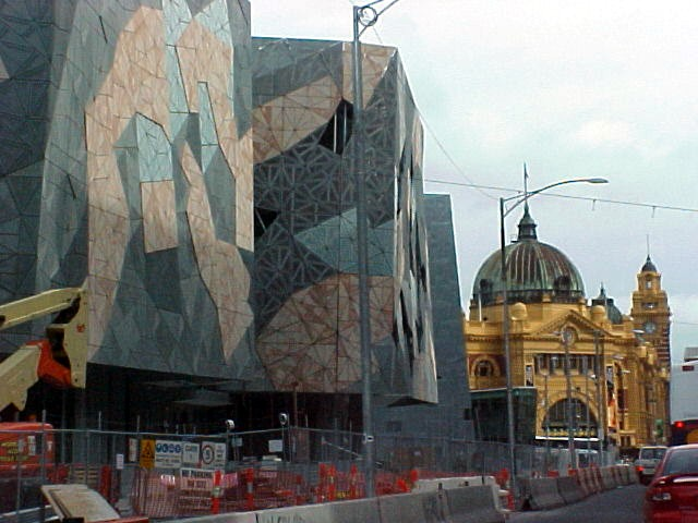 The contrast of one of the most ugliest things I have ever seen, next to one of the most beautiful buildings I have ever seen. The new train station, next to the original Flinders Station. This must be so embarrassing for Melbourne people!