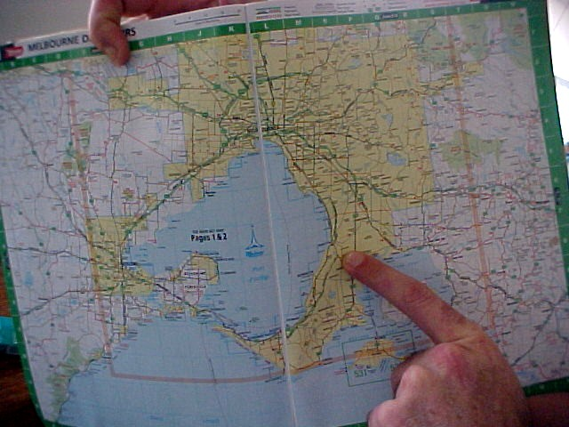 David points out where exactly I am on a street map. There is Langwarrin.