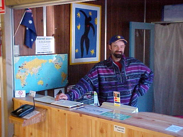 Mick posing behind the reception desk...