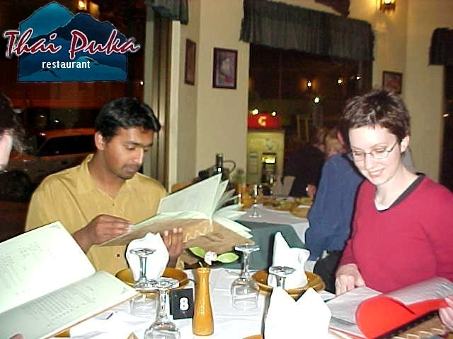 Ro and Jess at the Thai restaurant. Mmm.. Big menu...
