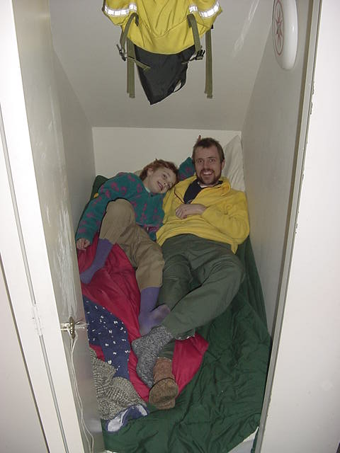 Well, how do I explain this. Canadians do not live in an iglo... but Jeff lives into the closet under the stairs at his cousins Peggy s house... Fletch joined him for this photo.