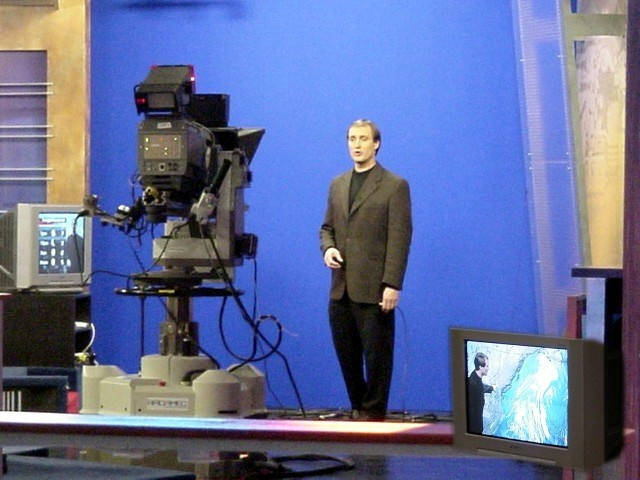 And there you see the BC weather man at work in front of a blue screen. You actually see the weather clouds on the tv.