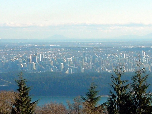 Look at that view onto West End and Downtown Vancouver! The green patch in front is the huge Stanley Park.