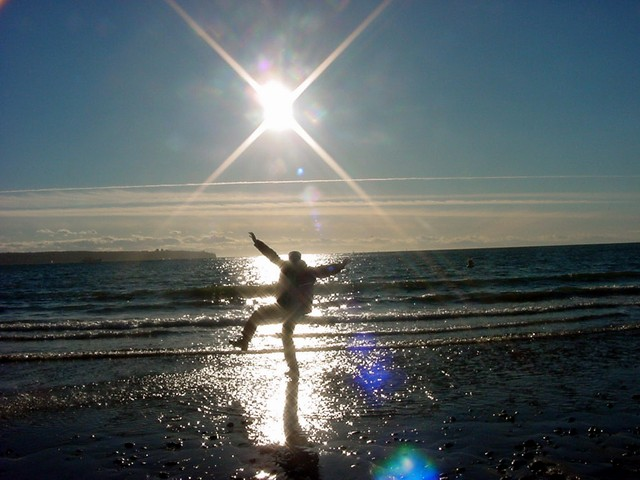 At Ambleside beach the winter sun was warm and bright. This is me touching the water of the Pacific Ocean!