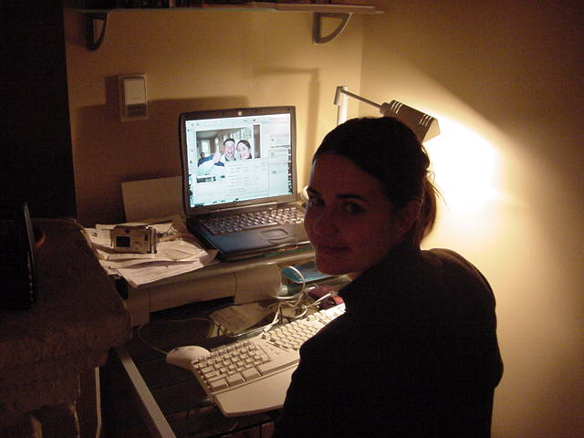 Fiona behind her own laptop, editting the photos she had made with her digital camera yesterday.