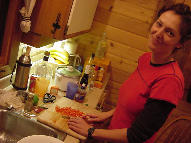 Kirsti is preparing tonights dinner, but looks up with a look of Is That Photo Really Necessary?
