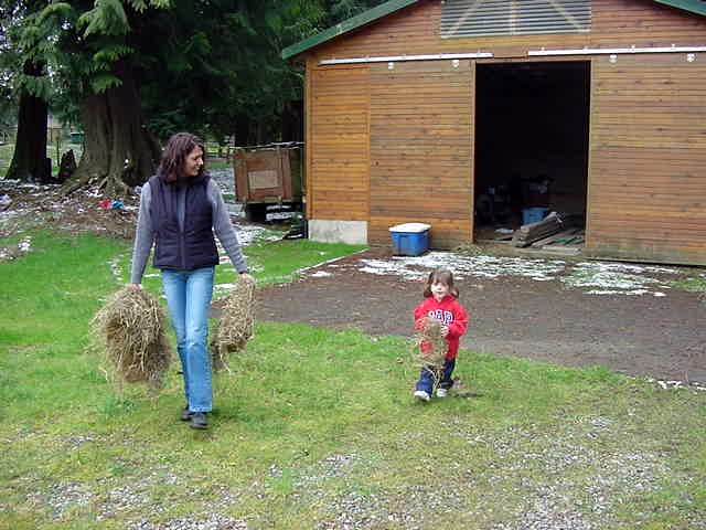 and feeds their horses outside with her daughter Porscha.