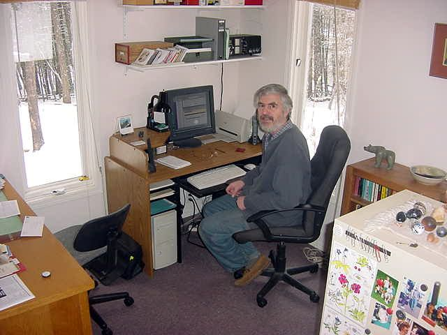 Jeffrey at his office of his web design company.