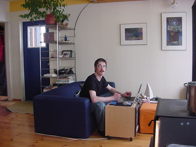 Thomas, jawohl, behind his laptop with a satellite Internet connection.