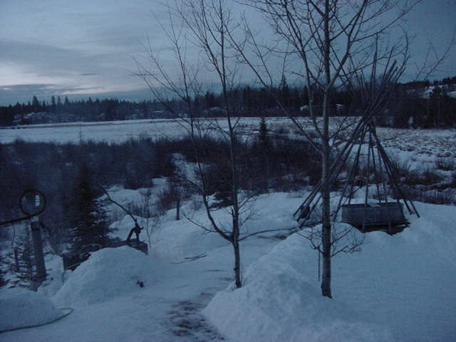 Outside, just after sunset at 6.30pm. The water in the tank (left) is boiling and the bath tub (right) is heating up...