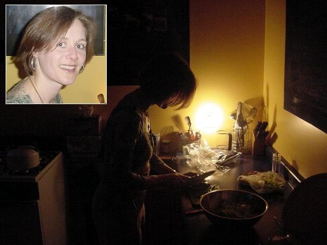Bettina prepares dinner in the kitchen.