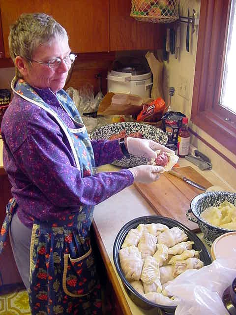 Karen prepared cabbage rolls in the kitchen. Never seen them before. It is meat with rice wrapped in cabbage. Cover it with tomatoes and stuff them in the oven for a while. Nice! But this is for tomorrow s dinner!