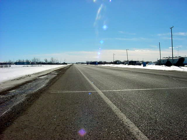And there I was on this empty road again, just north of Manning. Only locals passed by and big oil trucks, but trucks do not pick up hitchhikers off the ROAD any more.