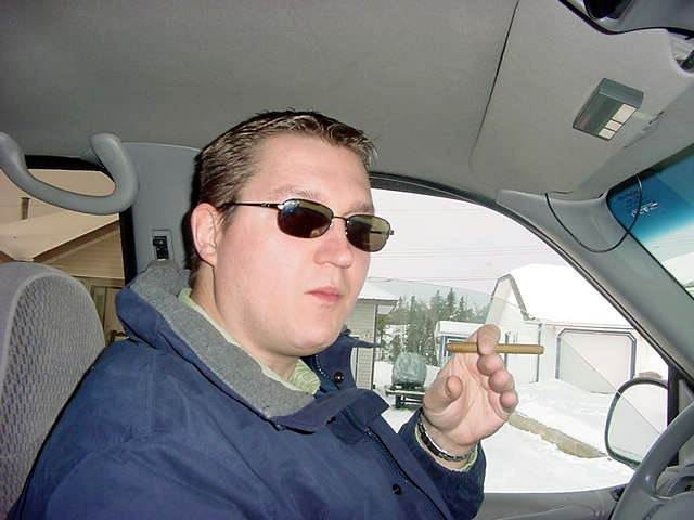Jeff in his truck on his way to the office. And he likes that the best with a Florida PomPom cigar.