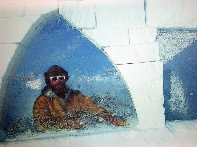 The Snowking posing through an ice window.