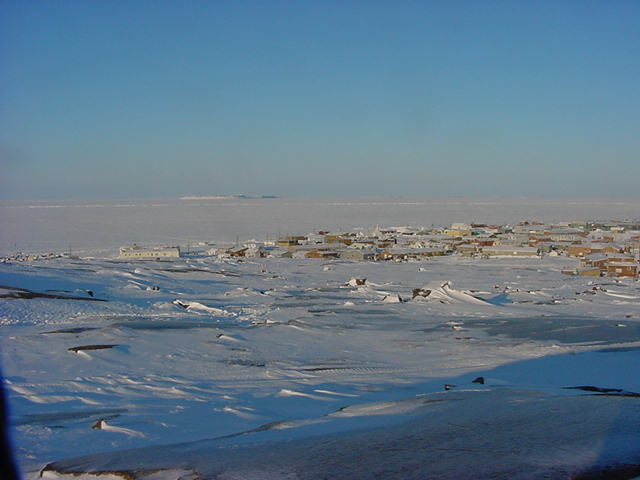 From the West of town, while sitting on the rocks, I overlooked Kugluktuk with the sun behind me. Wonderful.