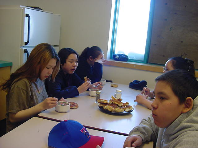 In the big school s kitchen eating lunch.