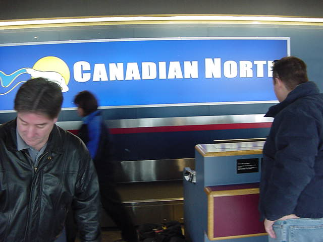 The only photo I could rescue from today s disk that pretty soon told me there is a Format Error: Jeff (at right) helps me with checking in at the Canadian North desk at the Yellowknife airport.