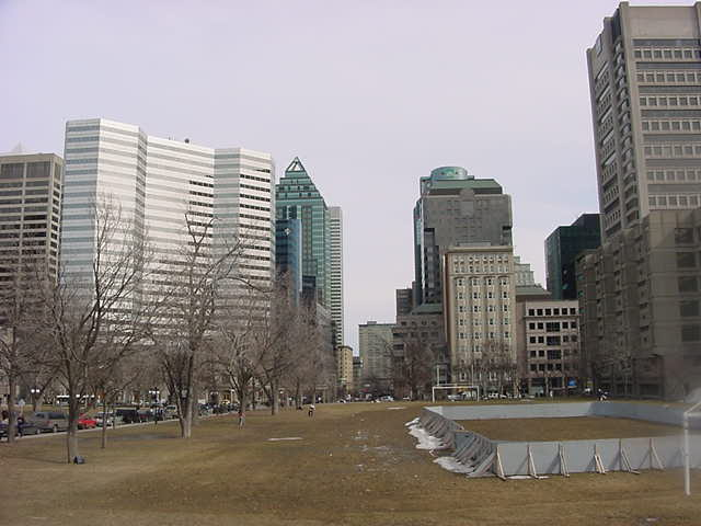 The city centre of Montreal as seen from the university grounds. At the front you see where the ice hockey ring used to be, not too long ago...
