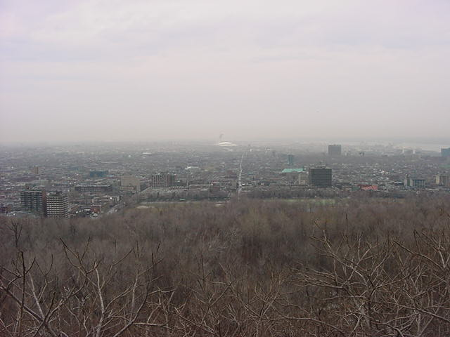 Looking over the east-end of the island of Montreal. In the mist you see the white Olympic Stadium of the 1976 Olympic Games. Financially seen they were the worst Olympic Games ever. Montreal residents are still paying taxe to pay off these Olympics.