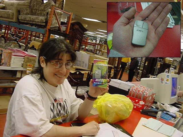 As seen at the local mall; Sandy shows one of the smallest computer mouses ever.