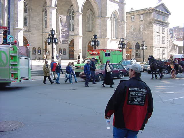 Movie shoots always go together with fire engines for safety. The producers will probably explode something, as Montreal is often used as a cheap look-alike of New York City. By the way, the fire brigade has painted their fire trucks green for almost a year now, as a protest against the end of their contracts. Some mayor messed up something.
