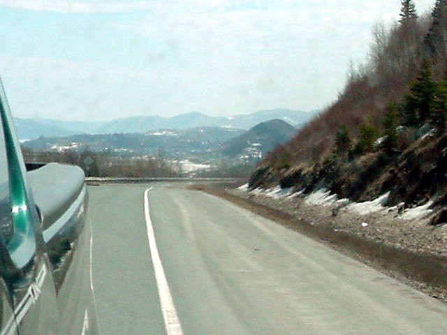 Looking back through the mirror of the car to Campbellton and the Sugarloaf Mountain...